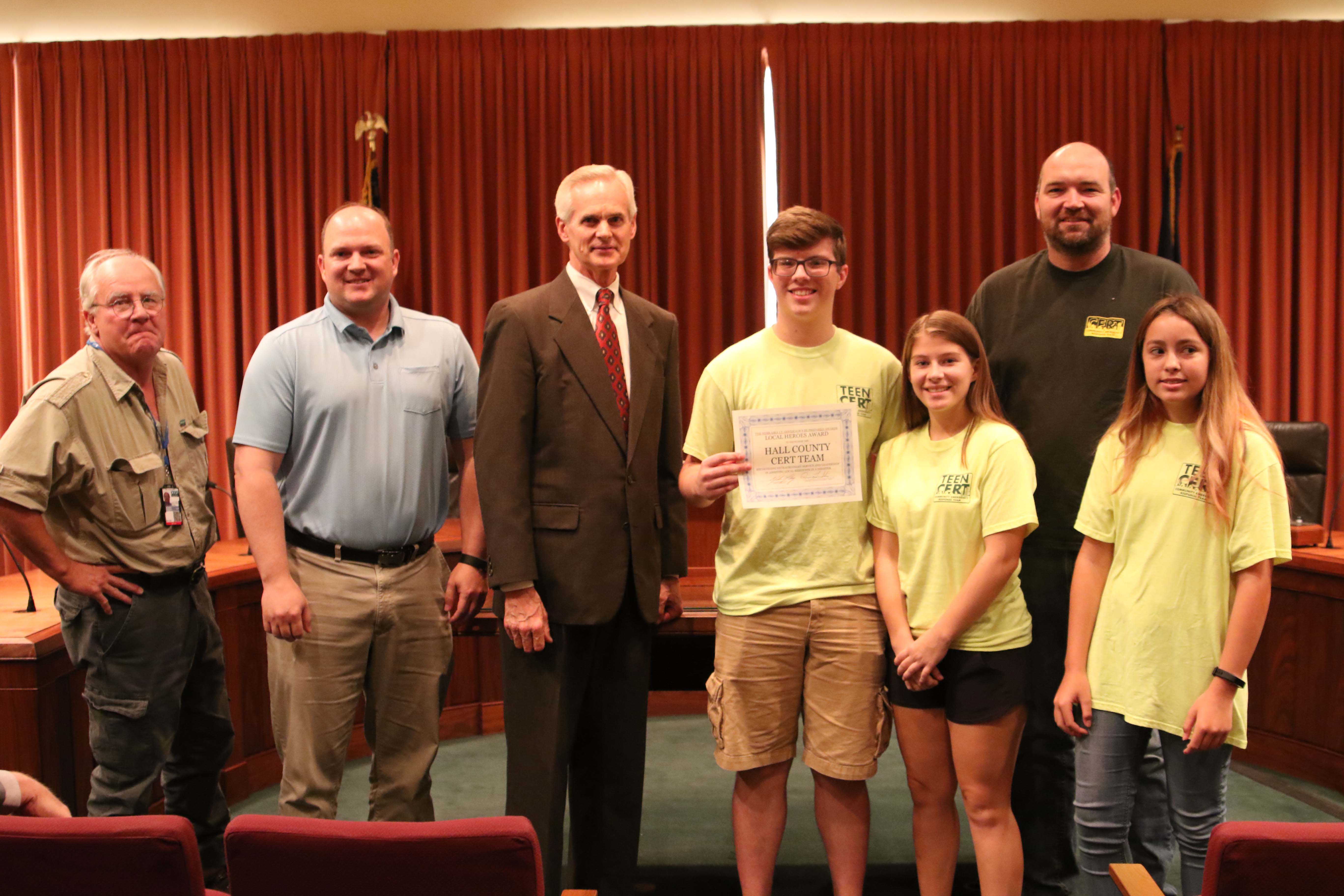 Lt. Gov. Mike Foley presents a Local Heroes Award to the Hall County CERT. Pictured from left, Lynn Guzinski, Aaron Wordyn, Lt. Gov. Foley, Jacob Weller, Ellie Mora, Jeremy Fanta and Destiny Lucero.