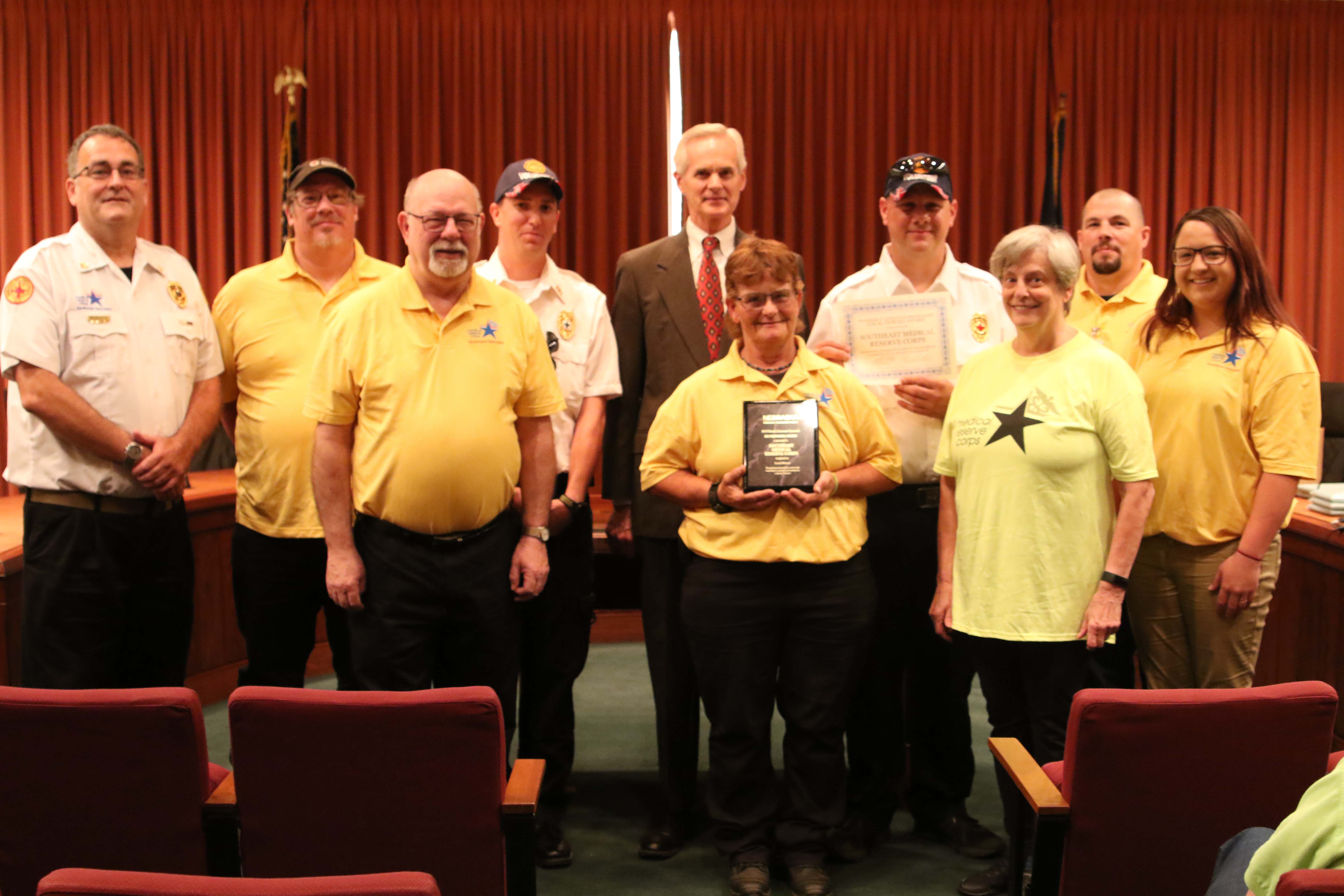 The Medical Reserve Corps of Southeast Nebraska was recognized by Lt. Gov. Mike Foley with a Local Heroes Award. Pictured from left are: Bill Montz, Kevin Rahe, Dennis Schmidt, Cody Meredith, Lt. Gov. Foley, Mari Flanagan, William Kimsey, Janice Jones, Richard Steckly and Ashley Douthit.