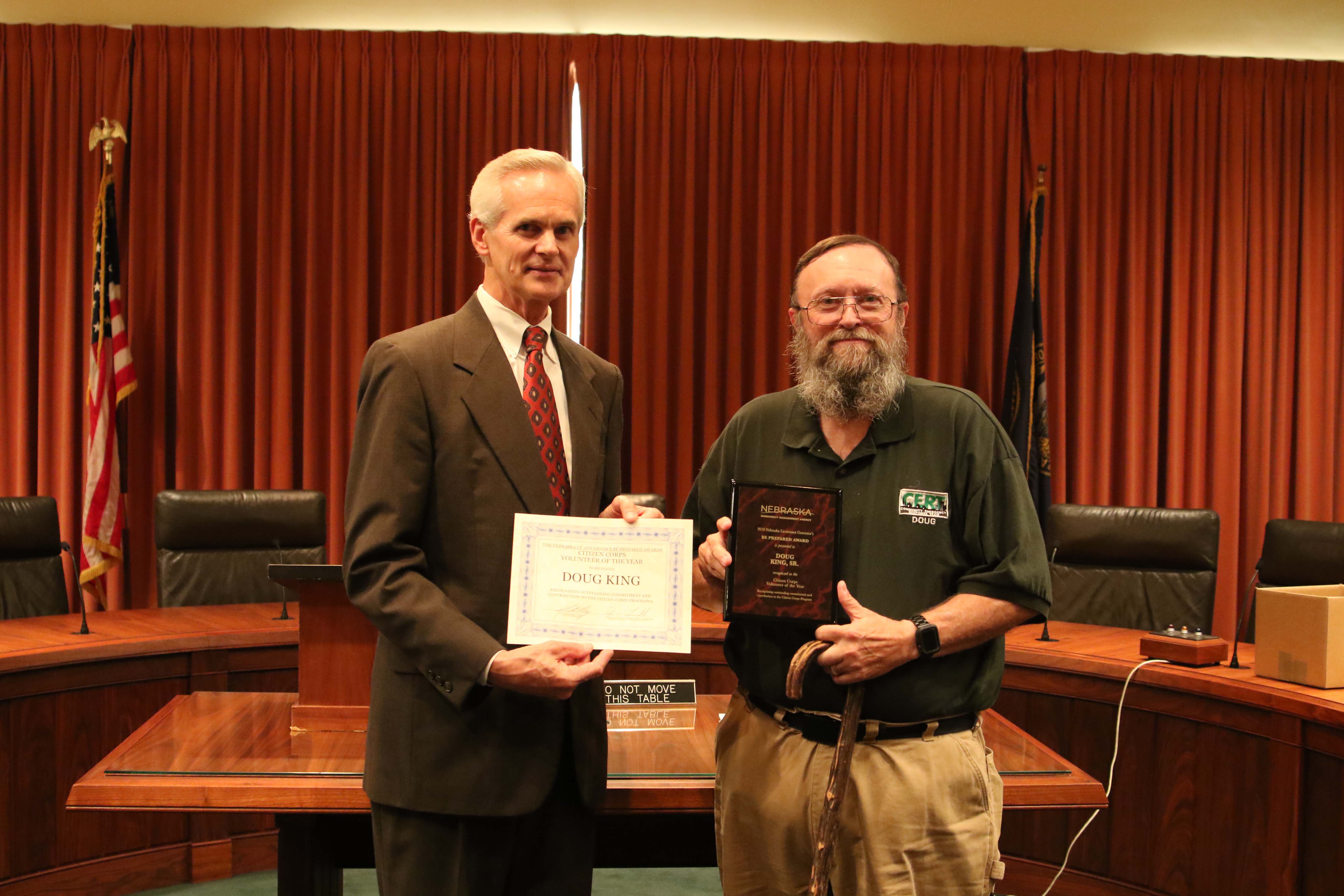 From left, Lt. Gov. Mike Foley presents Douglas King, Sr. of Bellevue with the Citizen Corps Volunteer of the Year Award.